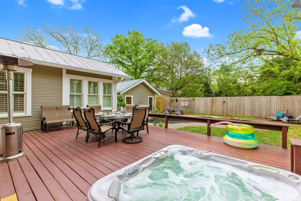Our hot tub is located at a great spot on the outdoor deck for you and your group to enjoy together!
