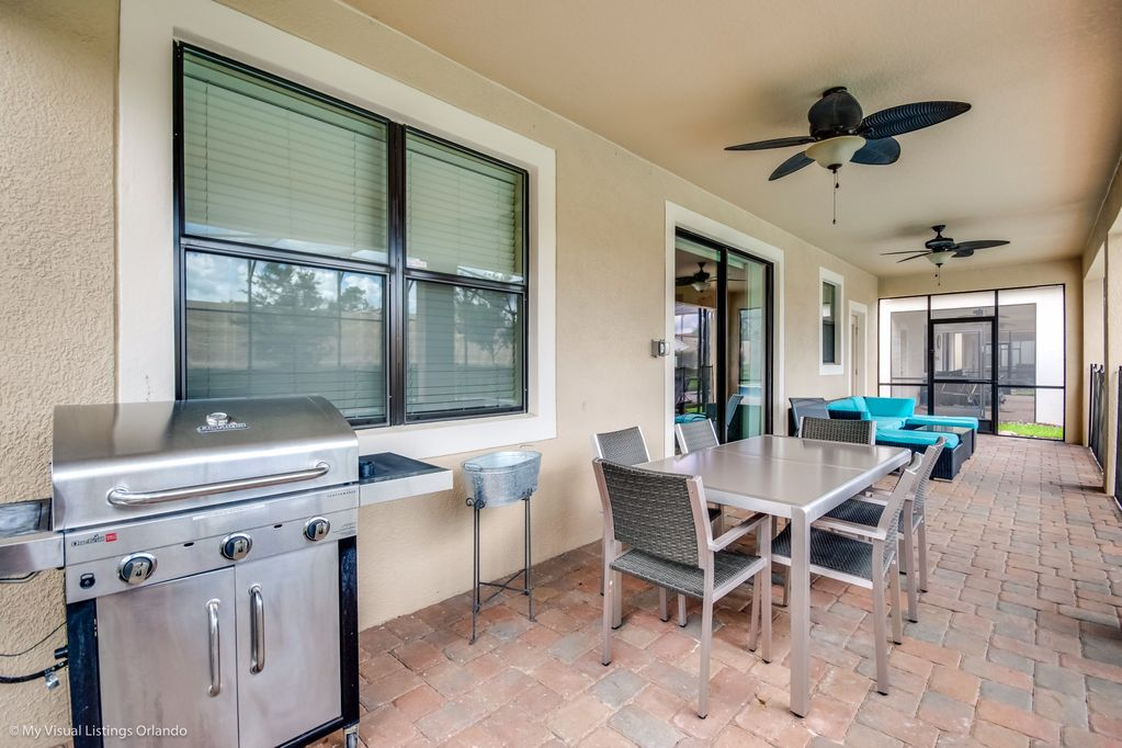 Open patio with grill and comfortable seating area