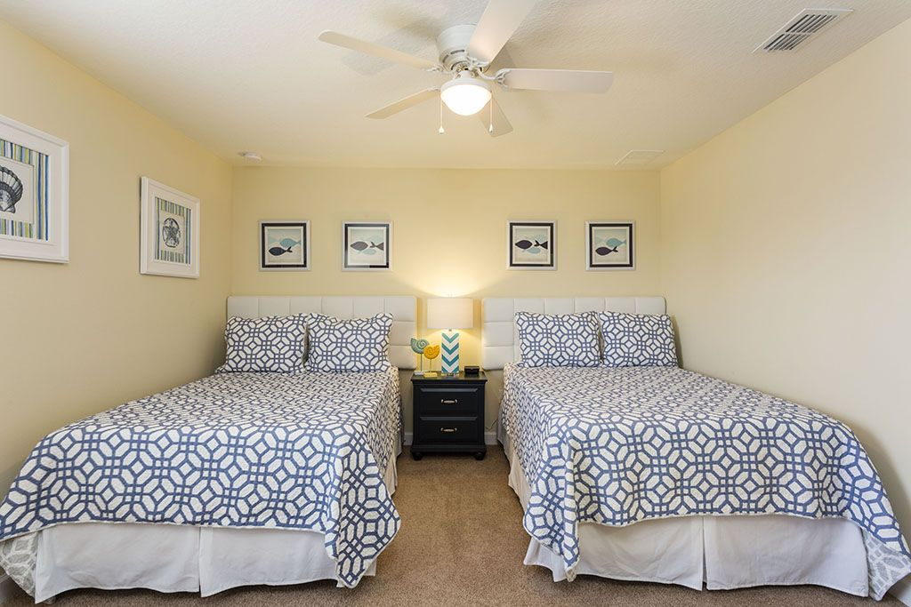 Ocean themed two full sized beds with flat screen TV