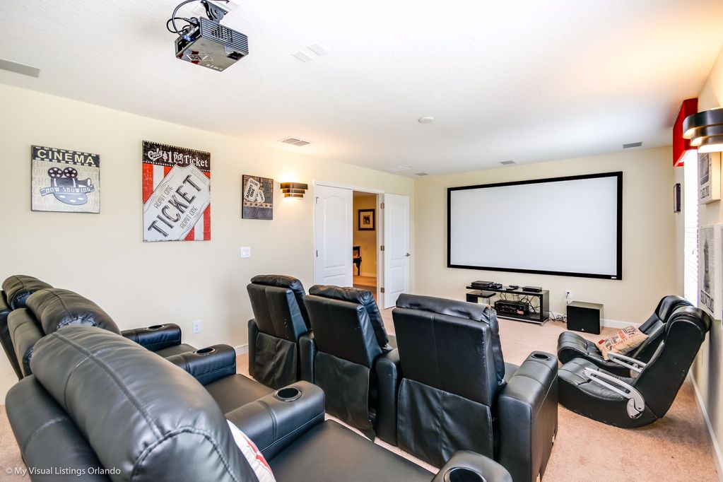 Spacious movie theater room with projector