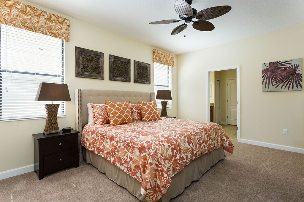 Pleasant king size bed with flatscreen TV and accommodating bathroom