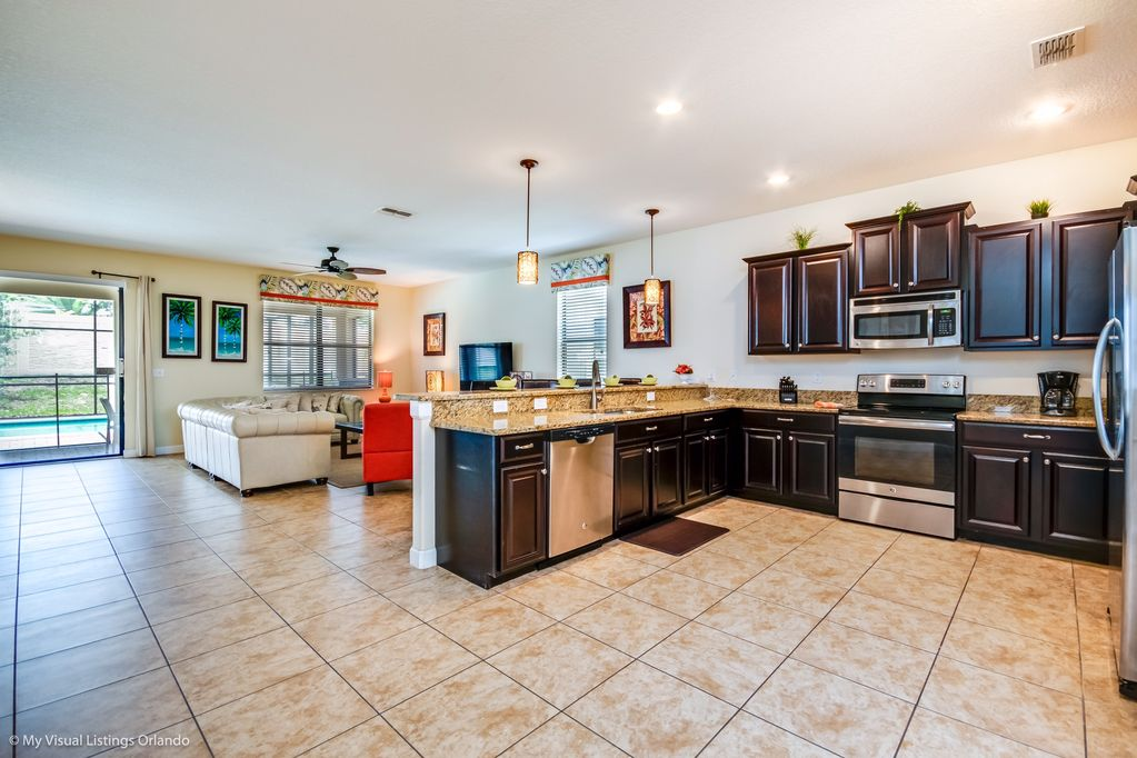 Gorgeous kitchen area with comfortable living room seating and flatscreen TV