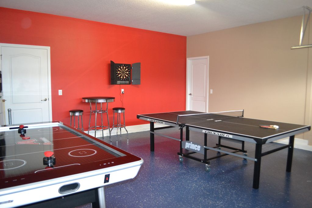 Game room with air hockey, ping pong table, and darts