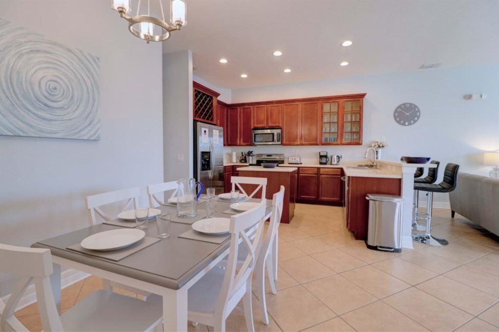 Classic dining table and kitchen area