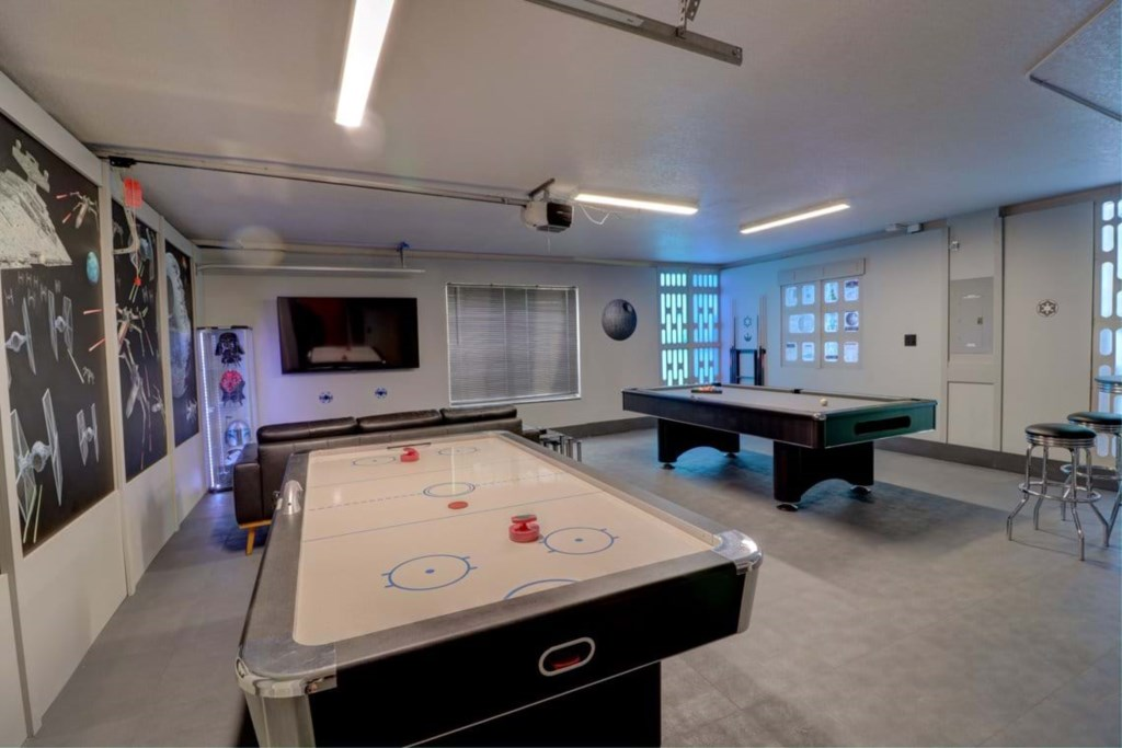 View 2 exciting Star Wars game room with air hockey, pool table, and lounge area with flat screen TV