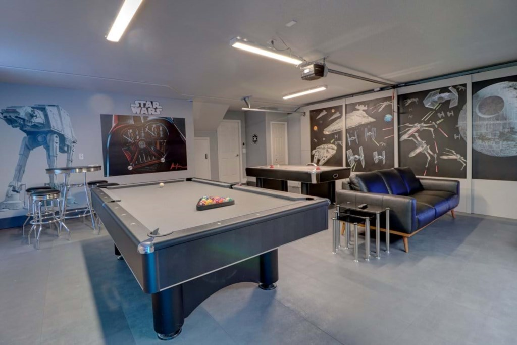 View 3 exciting Star Wars game room with air hockey, pool table, and lounge area with flat screen TV
