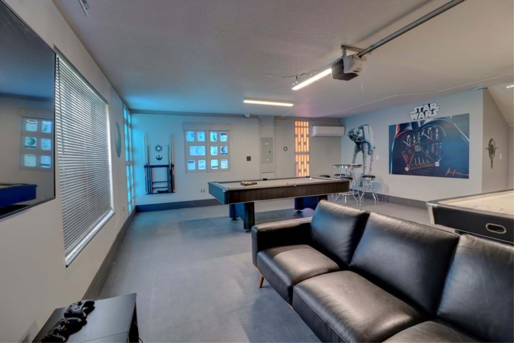 View 4 exciting Star Wars game room with air hockey, pool table, and lounge area with flat screen TV
