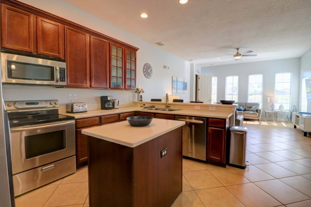 Oustanding kitchen area including microwave, stove, oven, and dishwasher