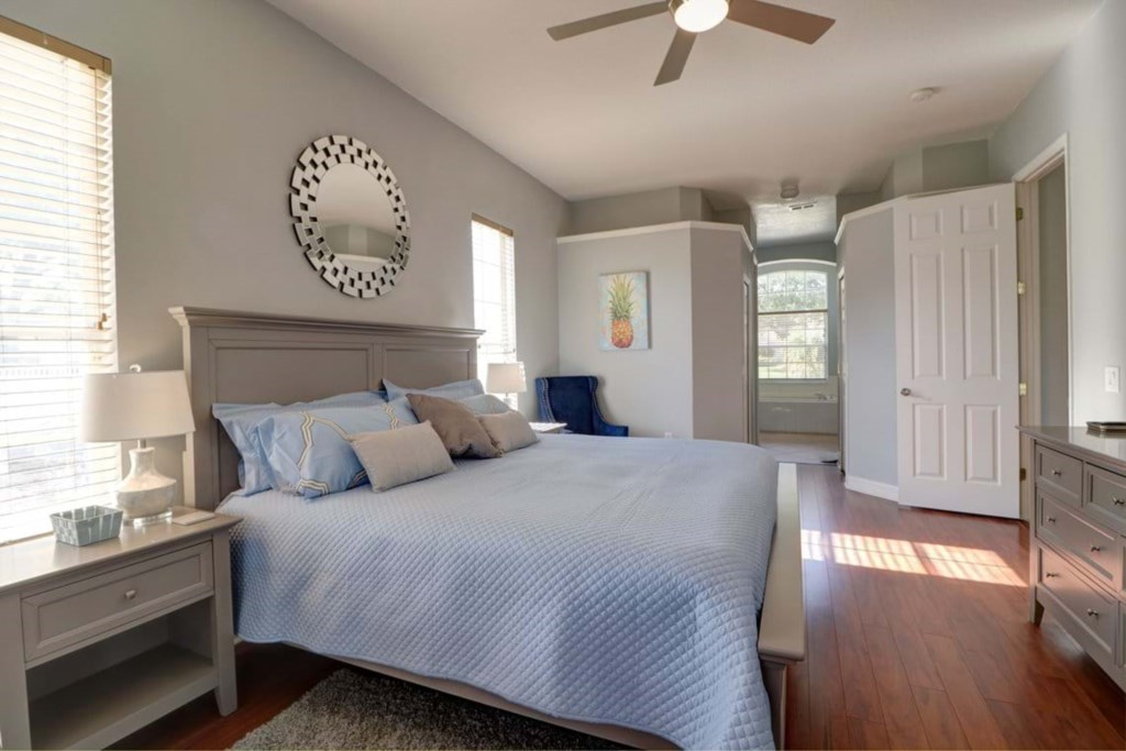 View 2 of elegant king size bed with flat screen TV and master bathroom