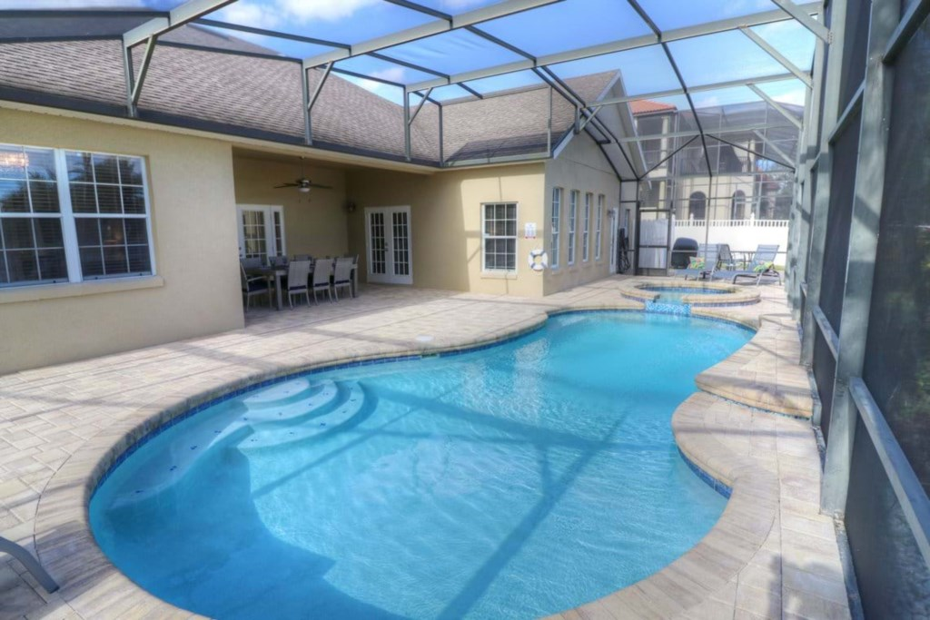 View 4 of gorgeous pool and spa with patio seating and loungers