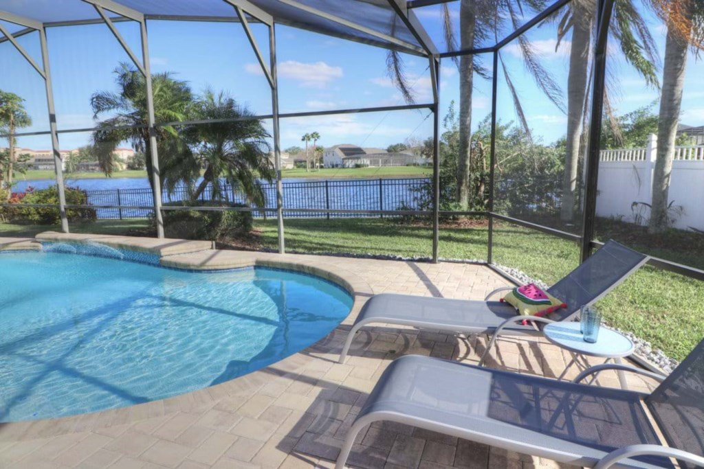 View 10 of gorgeous pool and spa with patio seating and loungers