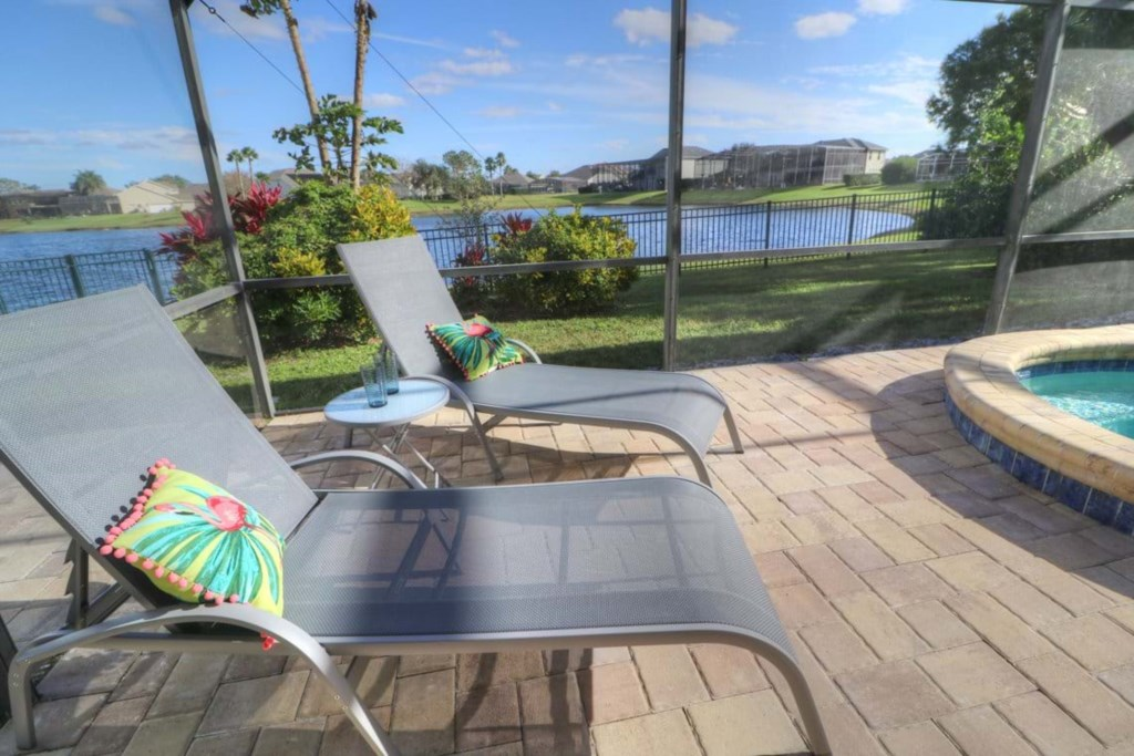 View 8 of gorgeous pool and spa with patio seating and loungers
