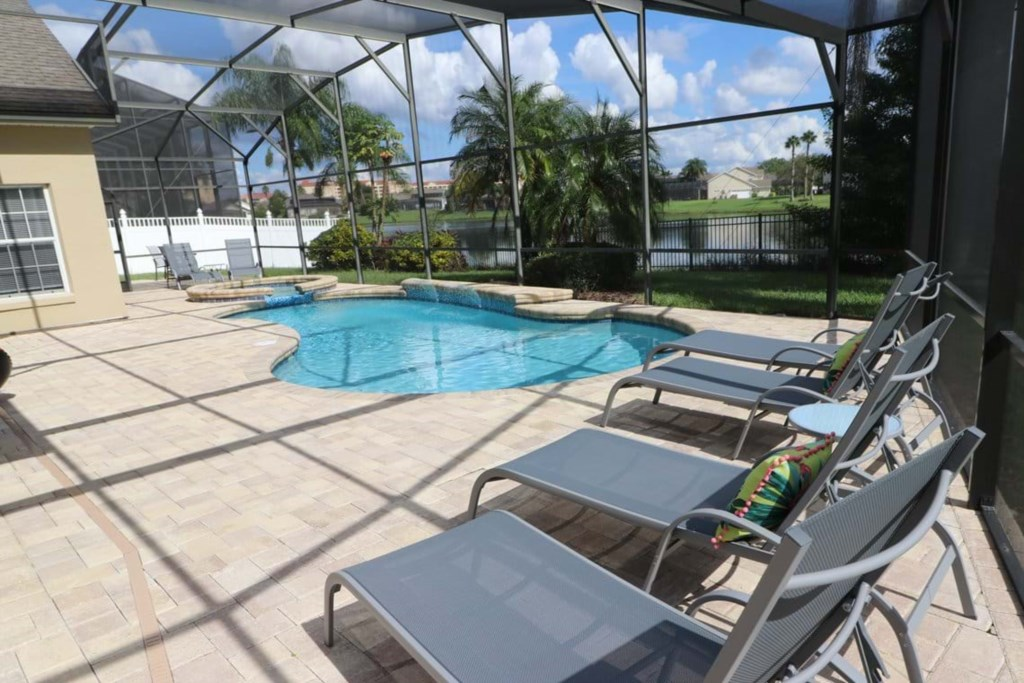 View 7 of gorgeous pool and spa with patio seating and loungers