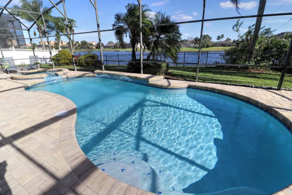 View 2 of gorgeous pool and spa with patio seating and loungers