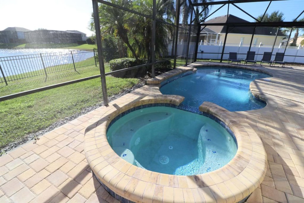 View 5 of gorgeous pool and spa with patio seating and loungers