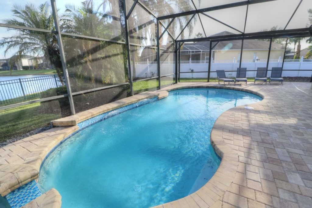 View 3 of gorgeous pool and spa with patio seating and loungers