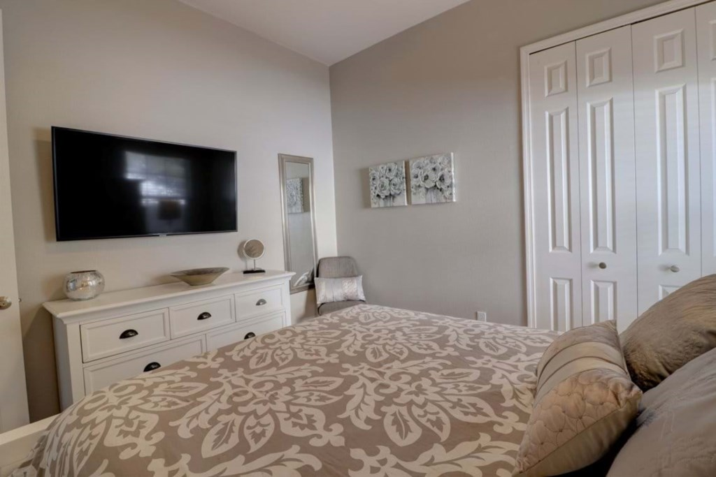 View 2 of classy queen size bed with flat screen TV