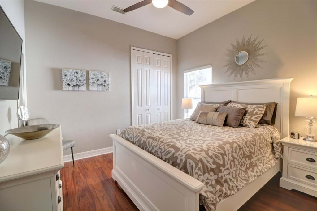 Classy queen size bed with flat screen TV