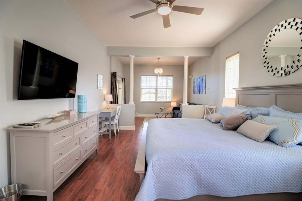 View 3 of elegant king size bed with flat screen TV and master bathroom