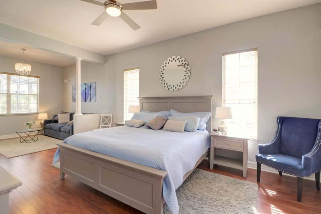 Elegant king size bed with flat screen TV and master bathroom