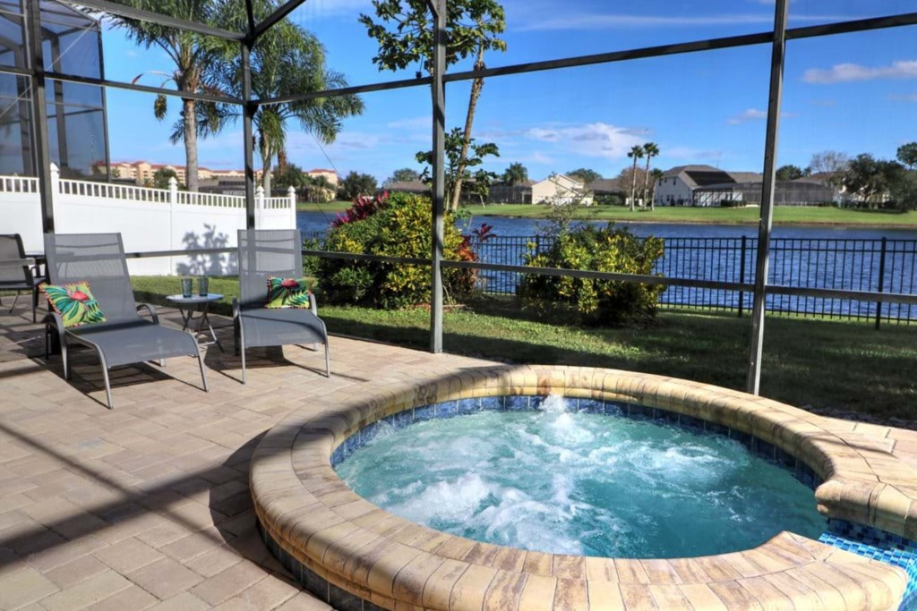 View 6 of gorgeous pool and spa with patio seating and loungers