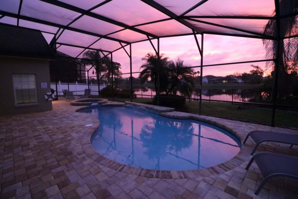 Gorgeous pool and spa with patio seating and loungers