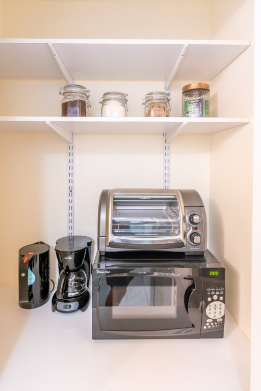 Wet Bar with a Small Refrigerator, Coffee Maker, Toaster Over, Plates, Cups and Utensils