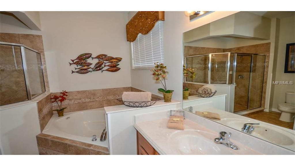 Master bathroom with walk in shower & tub. All towels provided.