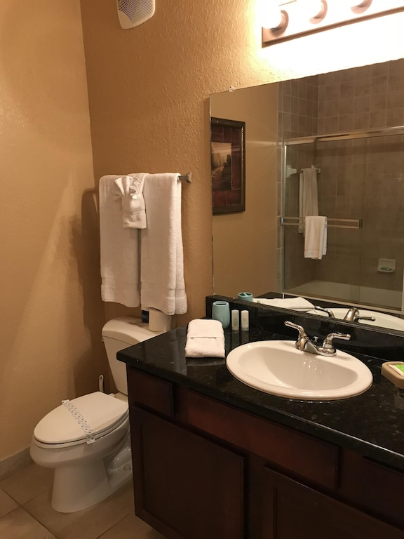 Family bathroom with shower/tub combo