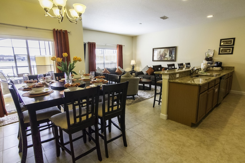 Dining/eat in kitchen area overlooking pool and lake