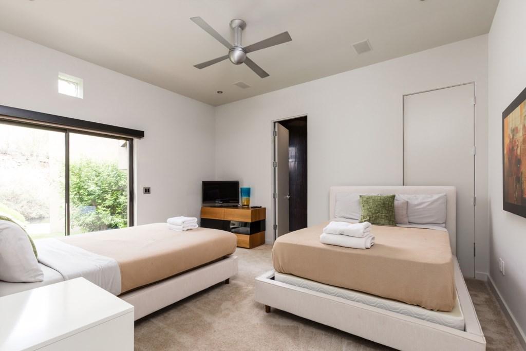 2nd Bedroom: 2 Double beds with en-suite bathroom