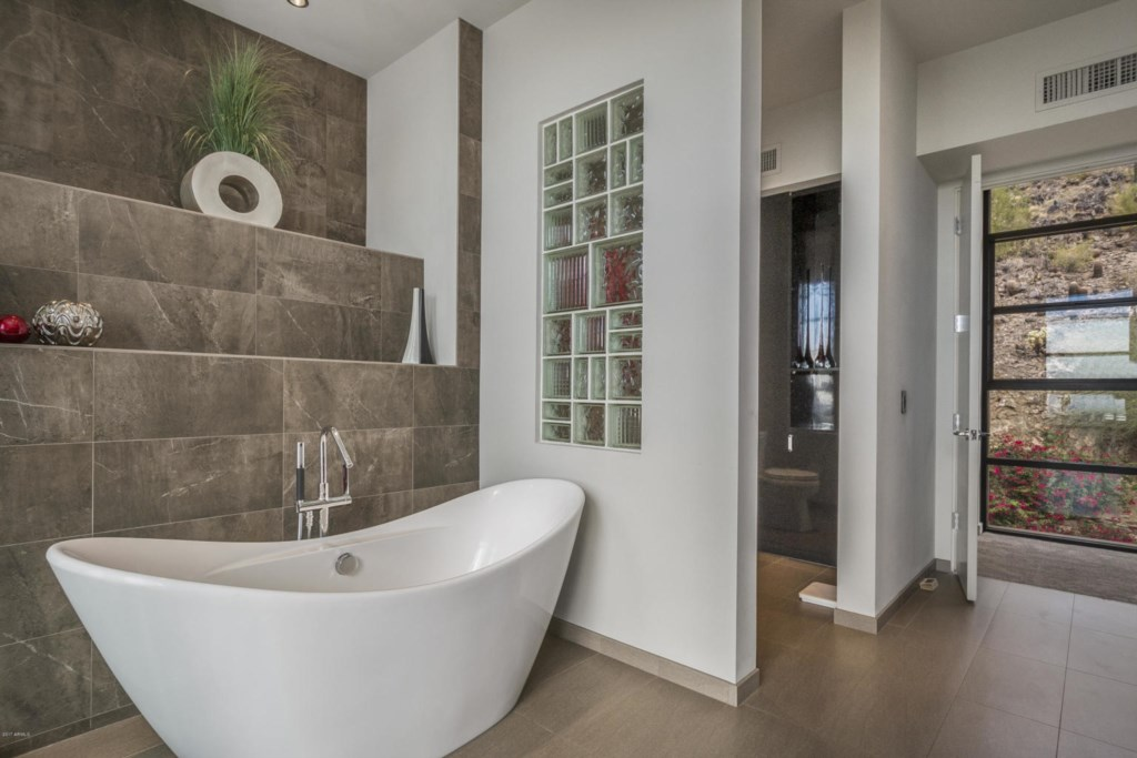 Master Bathroom with separate shower and floating tub