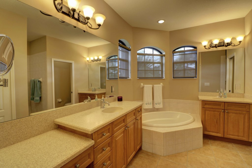 Large Master Bathroom with seperate tub and shower offering plenty of storage space