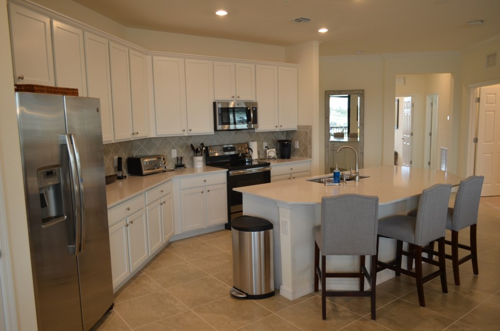 Boasting high end finishes and appliances with island and granite counters