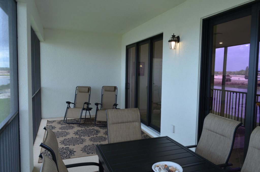 Spacious screened in Lanai to enjoy being outdoors at anytime of day or night
