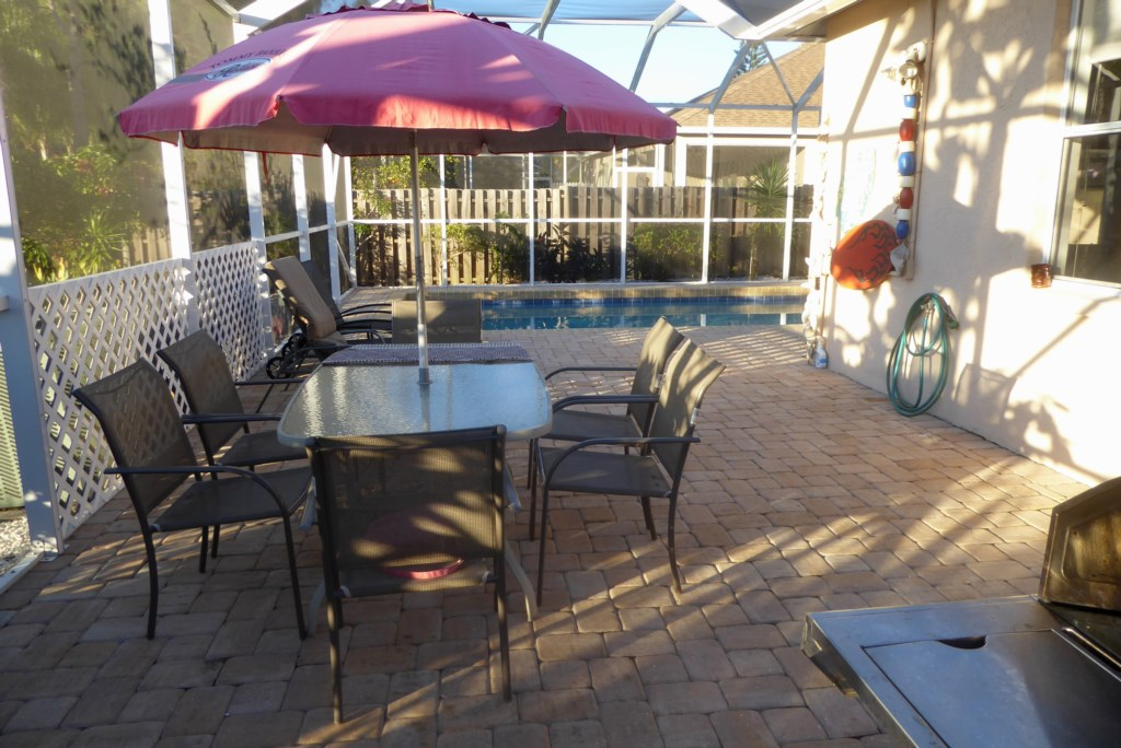 Screened-in pool area with dining table