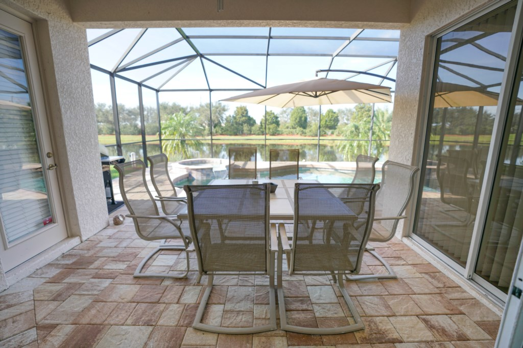 Covered and screened-in outdoor dining area