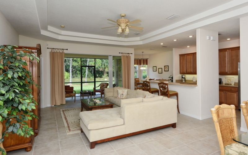 living room, open kitchen with breakfast bar