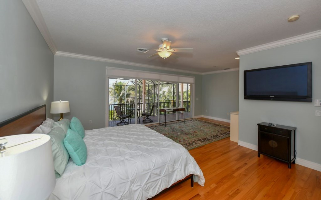Master Bedroom with Tv and Balcony