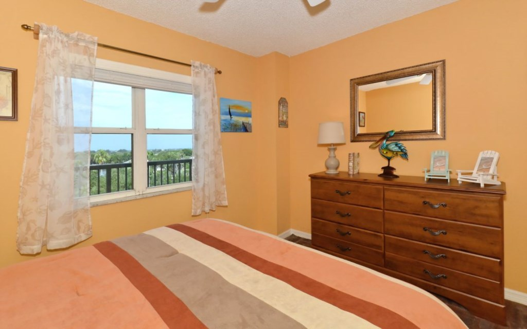 2nd Bedroom with dresser and view of Golf Course