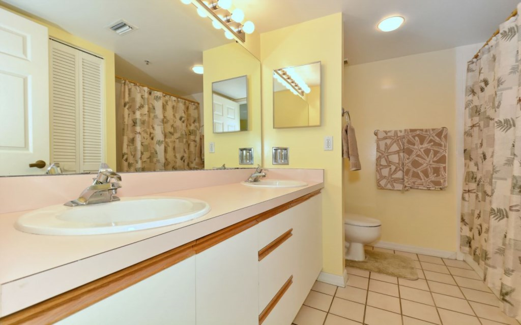 Master Bathroom with shower-tub and double sink