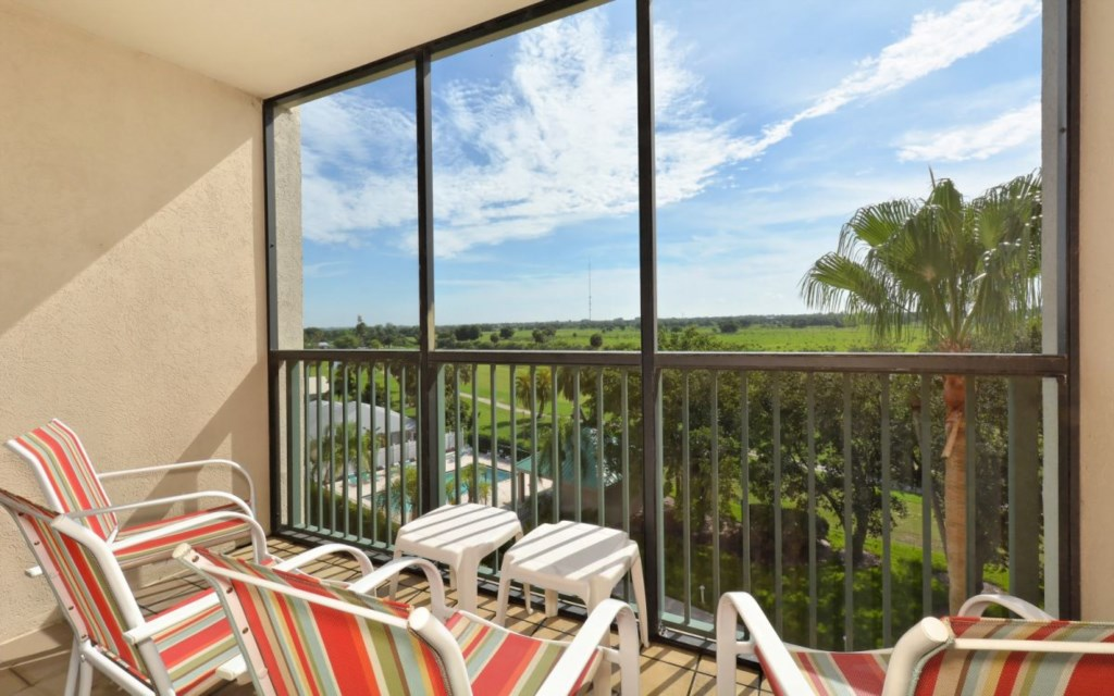 Screened balcony with view of community pool