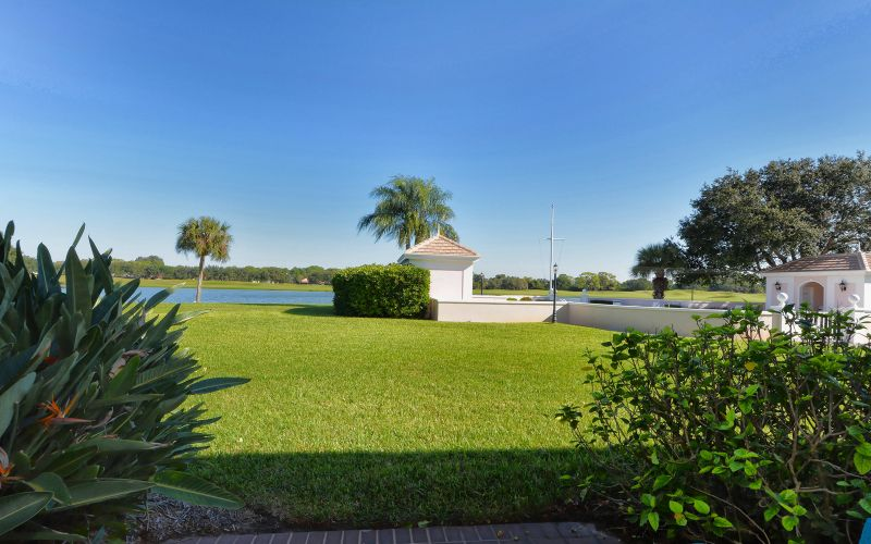 View from your patio - pool area, lake and golf course