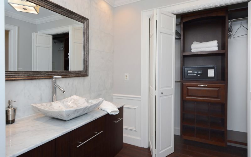 Bathroom with closet and integrated safe