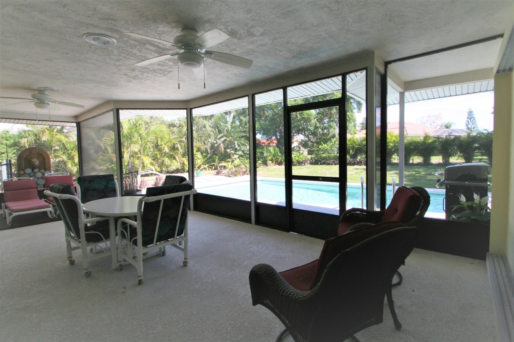 Screened-in and covered outdoor seating area