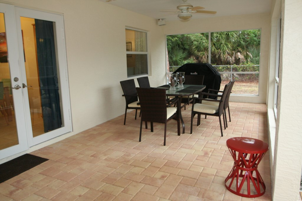 Screened-in and covered lanai with bbq