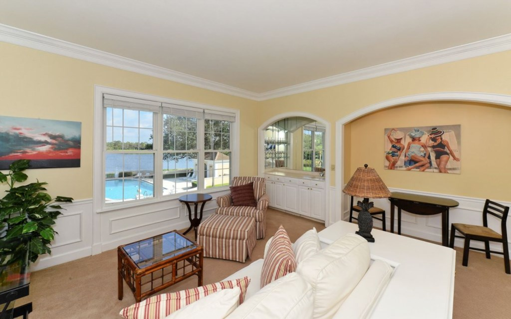 Living Room Area with Nook and View of Pool and Lake