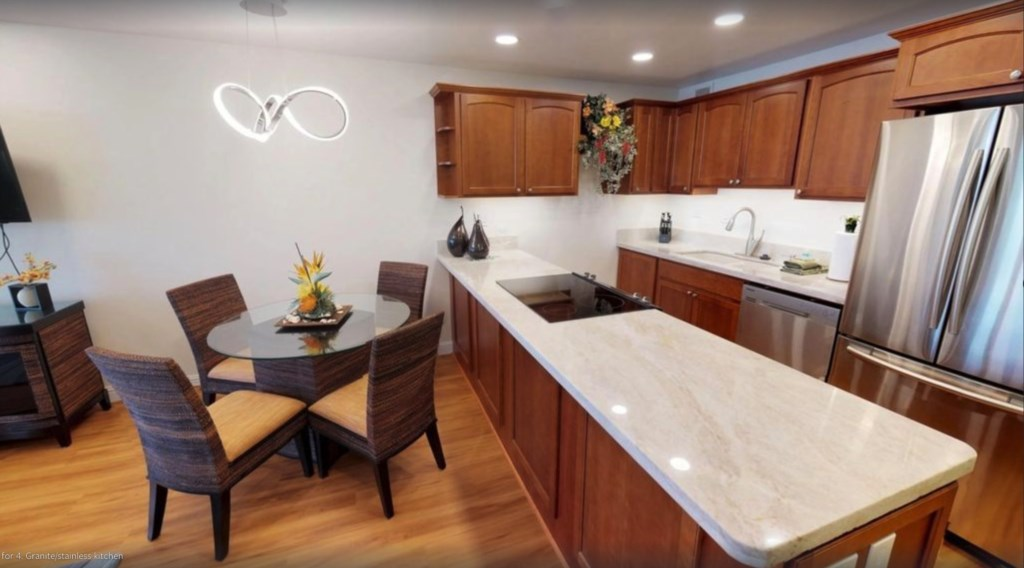 Newly renovated condo with hardwood floors, new cabinets, appliances and granite counters.