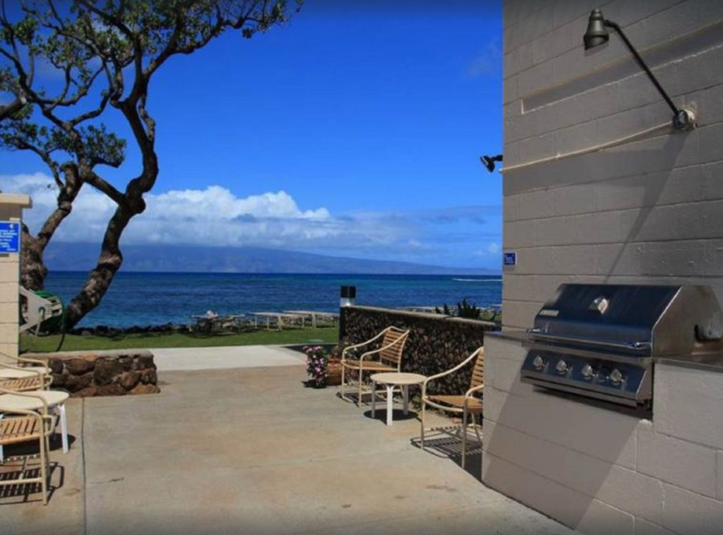 Outside BBQ facility with Ocean view and seating.