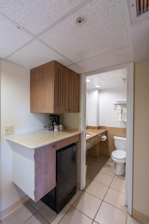 Mini refrigerator and bathroom area